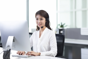 Woman at computer in white shirt